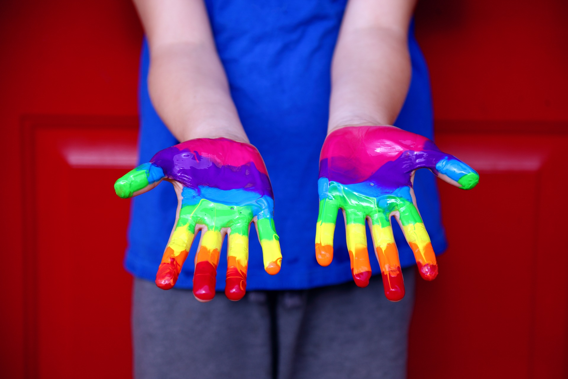 pride rainbow painted hands