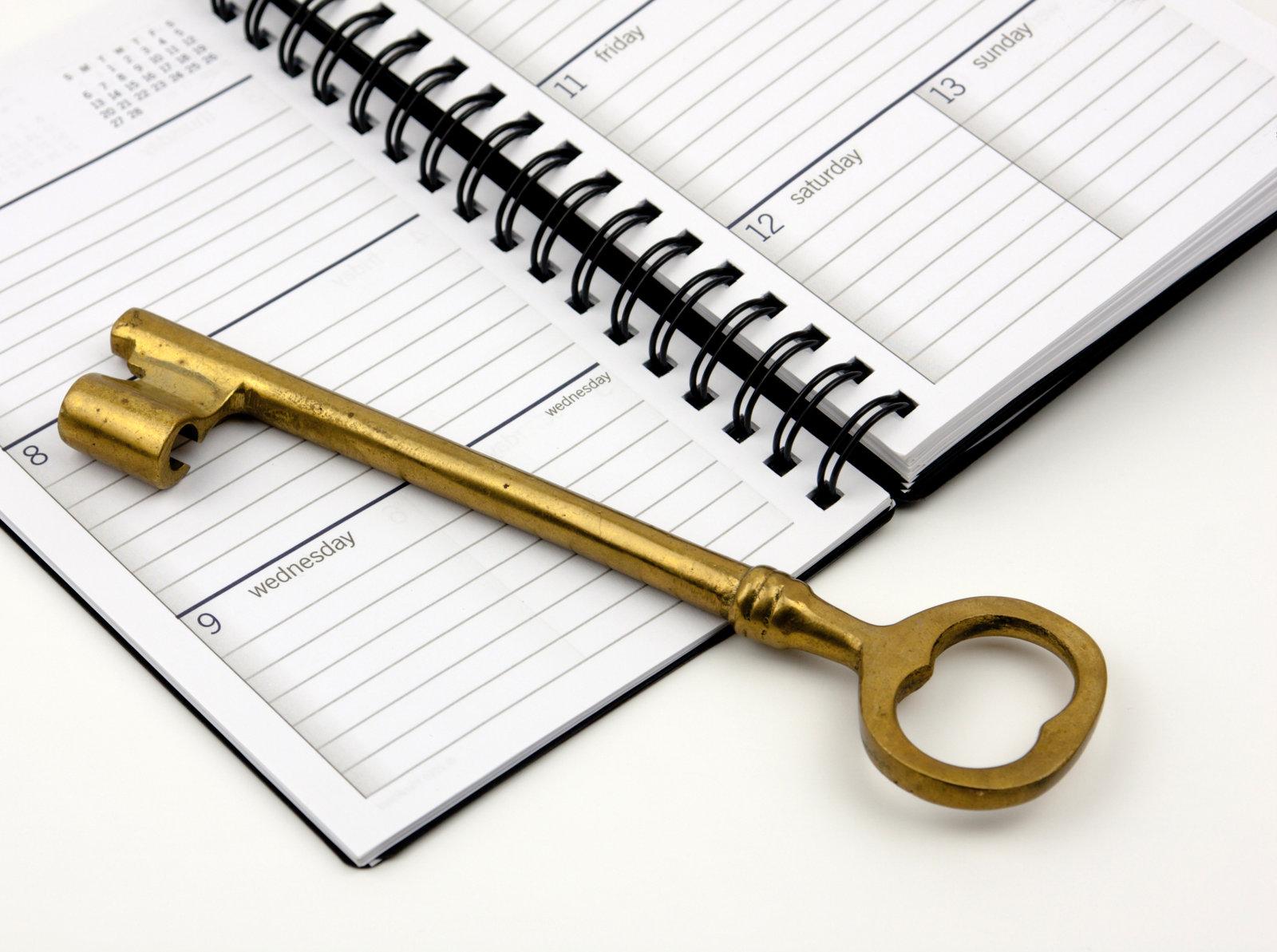 golden key on calendar planner